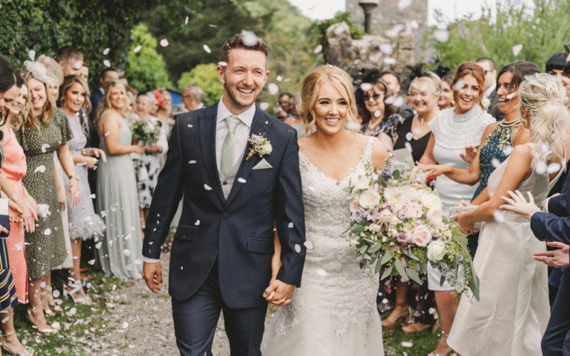 happy wedding couple walking through confetti fairyhill wedding